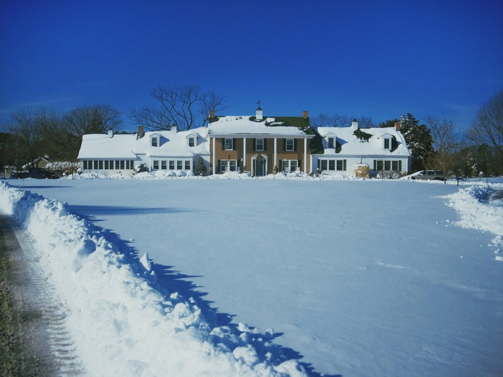 view of inn at huntingfield creek in winter
