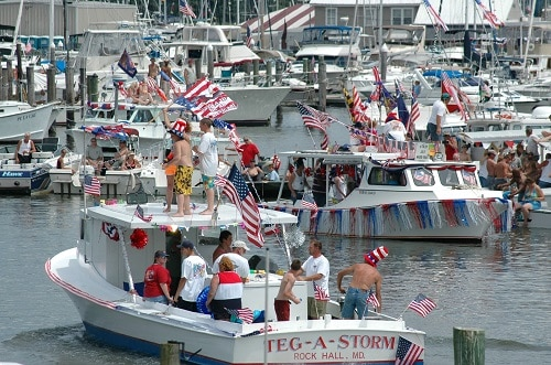 boats on the water with american flags