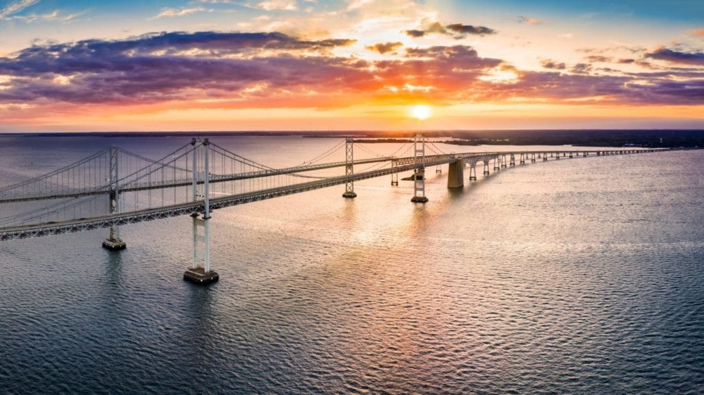 Aerial panorama of Chesapeake Bay Bridge at sunset. The Chesapeake Bay Bridge (known locally as the Bay Bridge) is a major dual-span bridge in the U.S. state of Maryland.